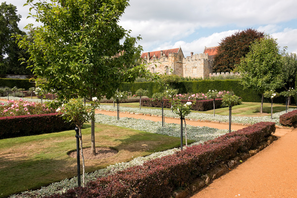 Formal garden and house: A formal garden at Penshurst Place, a stately home in Kent, England. Photography in these grounds was freely permitted.
