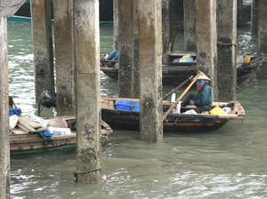 HALONG Bay: Locals on they daily routines... waiting for their turn to deliver stuff to the respective boats...