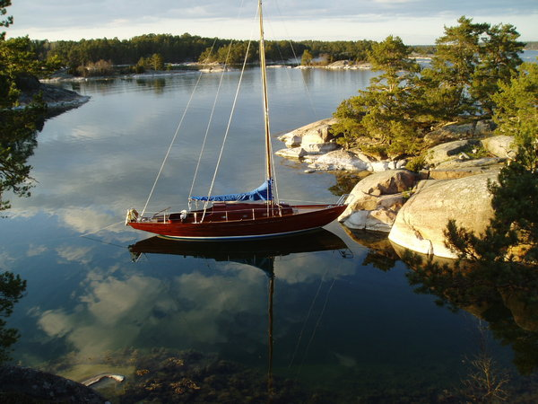 Evening in the archipelago: A sailing boat in the swedish archipelago