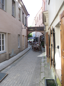 Narrow street: A narrow street in Vilnius with a small restaurant.
