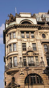Old London building: An old London building with a lot of decorations and adornments