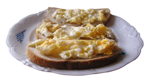 Scrambled eggs on bread: Eggs on bread.