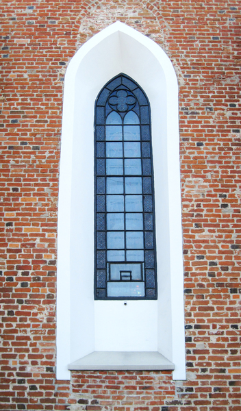 Old window: An old brick window of an old church in Tarczyn.