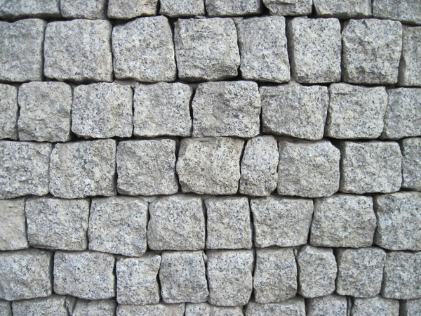Brick wall: A wall made of small stones shaped like bricks.