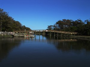 Reflections of Summertime: This waterway is located at Oak Island and goes into the Atlantic Ocean. The foot bridge provides a path to the beach.