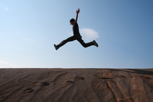 Jumping: Jumping a boy in desert of Iran.