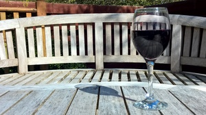 Glass of wine in the sun: Glass of wine sitting in the sun