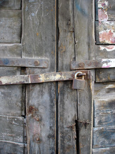 Lock me up: An old, padlocked door
