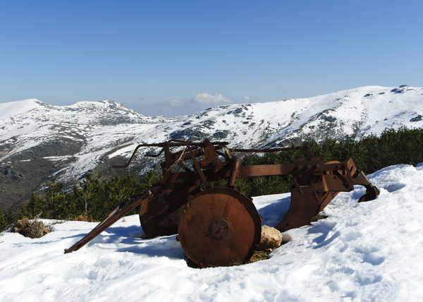 and snow plow: abandoned on  a mountain with snow plow