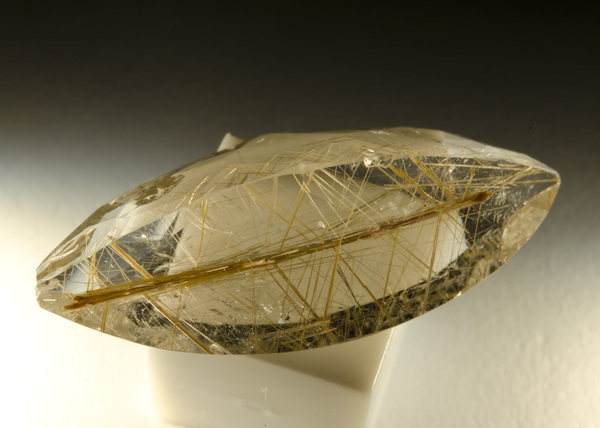 Rutilated quartz: Rutilated quartz is a variety of quartz in which thin long needle-like forms of rutile are created within the quartz. These rutile enclosures resemble beautiful, colorful fibers encased within the mineral.