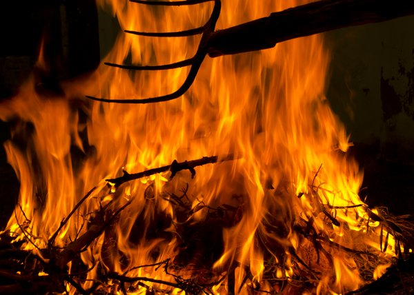 Fire and pitchfork: Fire on a background with pitcfork