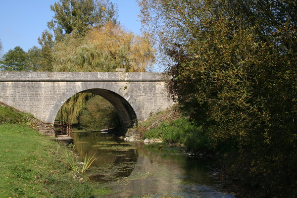 To the Bridge: the river in Vaux en Couh� in sw France on a lovely summer day