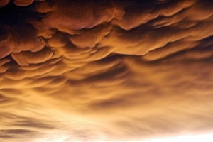 Storm's Death: Storm leaving the Texas Gulf Coast at sunset.  red tint comes from setting sun.