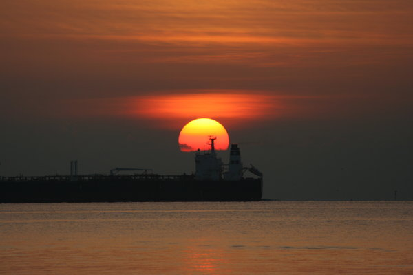 Ship & Sunrise: Ship returning to port got in the way of my taking a pic of sunrise on 7-25-05.  Galveston Bay
