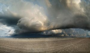 Storm clouds over the beach: A fierce storm had just passed and the late evening sun was breaking out