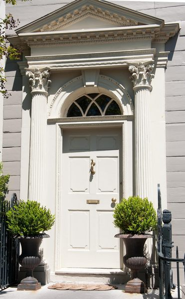 Neo-classical doors III: Neo-classical doors from the late 18th and early 19th centuries. Shot in direct sunlight in Charleston, South Carolina, USA