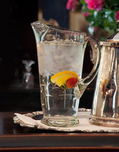 Water Pitcher with fruit: This water pitcher was resting on the bar of a high class inn. This is how water should be served
