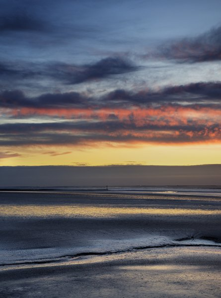 shades of the evening sun 2: morecambe bay just after sunset morecambe bay just after the sun went down,with a slight hdr look,made of 3 images