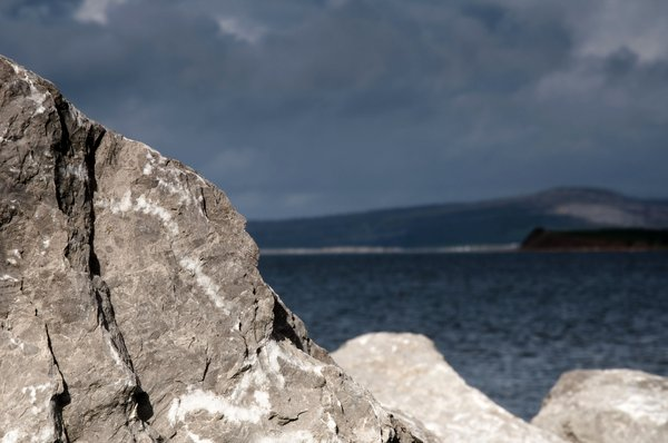 rocky: taken on the seafront at morecambe looking towards the distant hills with limited depth of field