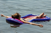 Sexy Girl Floating on raft: Girl floating on raft in clam waters