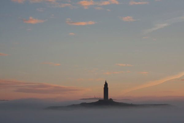 The tower over the fog: Ancient Roman lighthouse. The structure is 55 metres (180 ft) tall and overlooks the North Atlantic coast of Spain. The structure, almost 1900 years old and rehabilitated in 1791, is the oldest Roman lighthouse still used as a lighthouse. UNESCO World