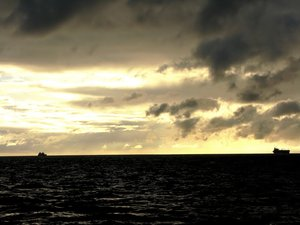 Dusk at Sea: Darkening of the waters, ships settled in for the night