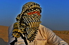 Arabic Indian Man in desert: Arabic sun tanned, Indian man in desert with head scarf a traditional culture that is going on for hundreds and hundreds of years in the Arabic countries and in Saudi Arabia . Photos in desert on the desert hill with sand only in the area and everywhere i