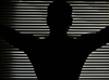 Black silhouette in darkness: Man silhouette in darkness with stripes of light as patterns on background