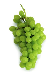 Grapes: Green grapes, isolated on white background.