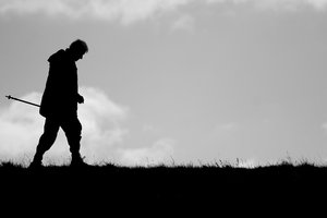 Old Man Walking: Old Man Walking in Silhouette
