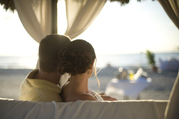 Facing out.: The newlyweds on a Cabana chair.