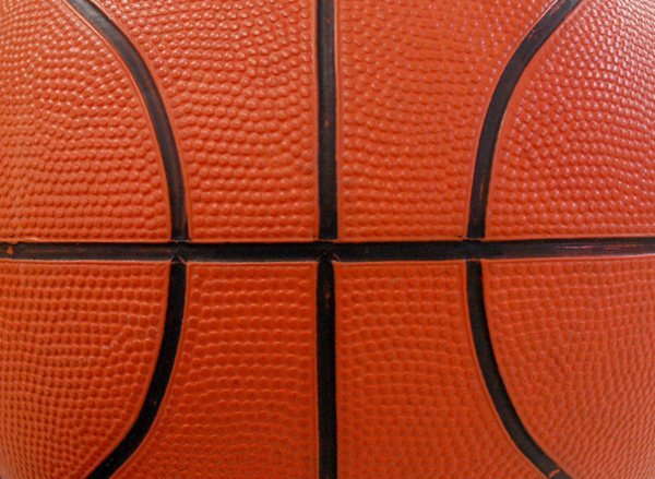 Basketball Background: Close up of a basketball with the classic seam pattern for backgrounds