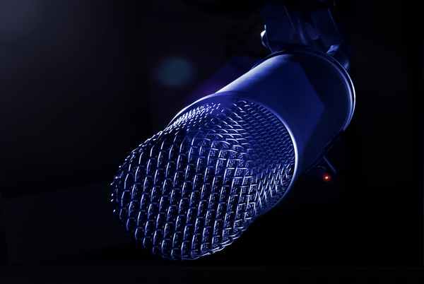 On The Air: Close up of a studio microphone while live on the air.