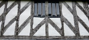 Tudor beams: Beautiful pattern of oak beams in Tudor building in Suffolk.