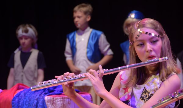 Flute player: Young flute player.