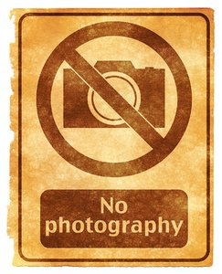 No Photography Grunge Sign: Grunge textured No photography sign on vintage paper, with sepia toning for a more aged feel.
