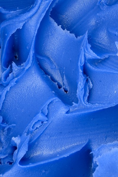 Blue Icing Texture: Macro peanut butter texture colorized blue to simulate icing on a cake.