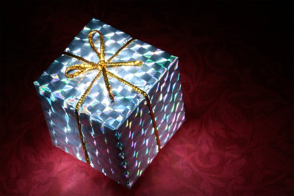 Glowing Gift Box: Long exposure close-up of a small gift box illuminated with a small flashlight for the glowing effect.