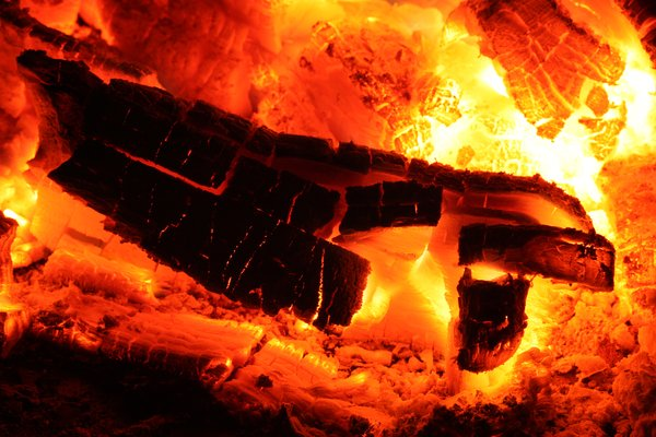 Glowing Fire Embers: Long exposure close-up of glowing fire embers from a campfire.