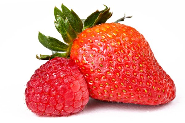 Berry Mix: Close-up of a strawberry and raspberry isolated on a white background.