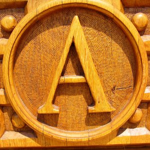 Letter A: A Letter A, carved into the door of the church at Sirok in Hungary