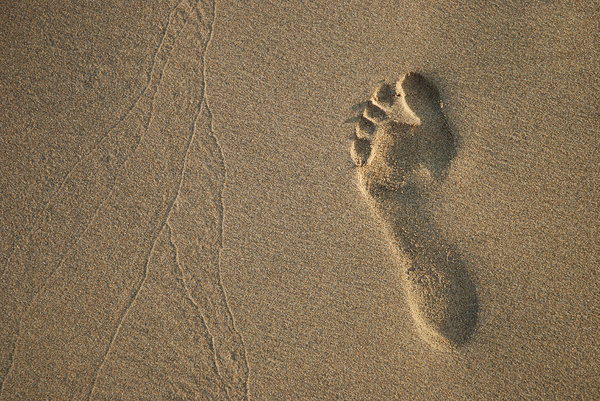 Imprints: Imprints by foot and waves.