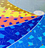 pavement mosaic: spiraling rainbow coloured pavement mosaic