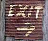 rusty sign2: rusty exit sign on old rustic wood