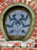 Scottish window: horseshoe-shaped stained glass window with Scottish symbols - seen from the outside