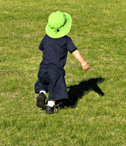 ready to play: young toddler - boy with ball and shadow