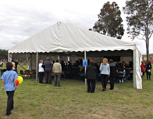tent meeting: group of people meeting in a tent