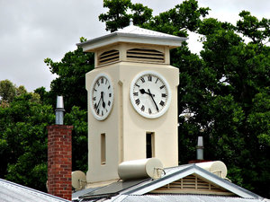 camp clock tower: old, non-functioning camp complex clock tower