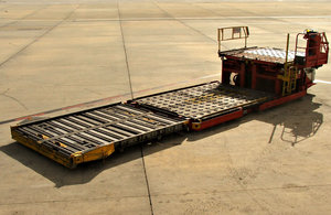 arrival readiness: tarmac trolleys lined up ready for unloading arriving aircraft