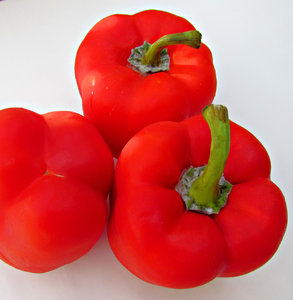 sweet red peppers: fresh bright red capsicums - red peppers